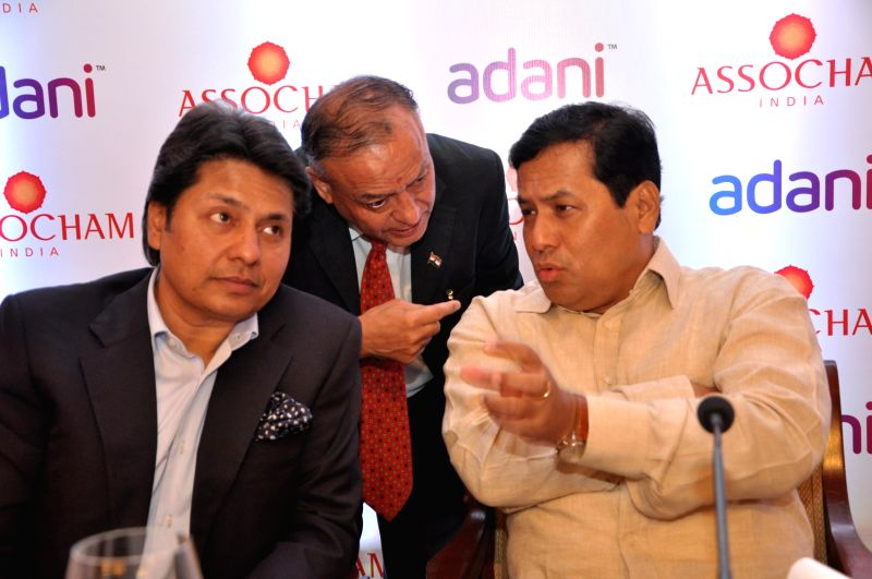 ASSOCHAM Secretary General D.S. Rawat with Minister of State for Youth Affairs and Sports (Independent Charge) Sarbananda Sonowal during `ASSOCHAM Young India @ 2030 Conclave: Preparing the Nation` ..