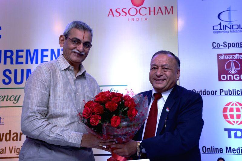 ASSOCHAM Secretary General DS Rawat welcomes Central Vigilance Commission KV Chowdary during ASSOCHAM Public Procurement Summit in New Delhi on July 27, 2016.