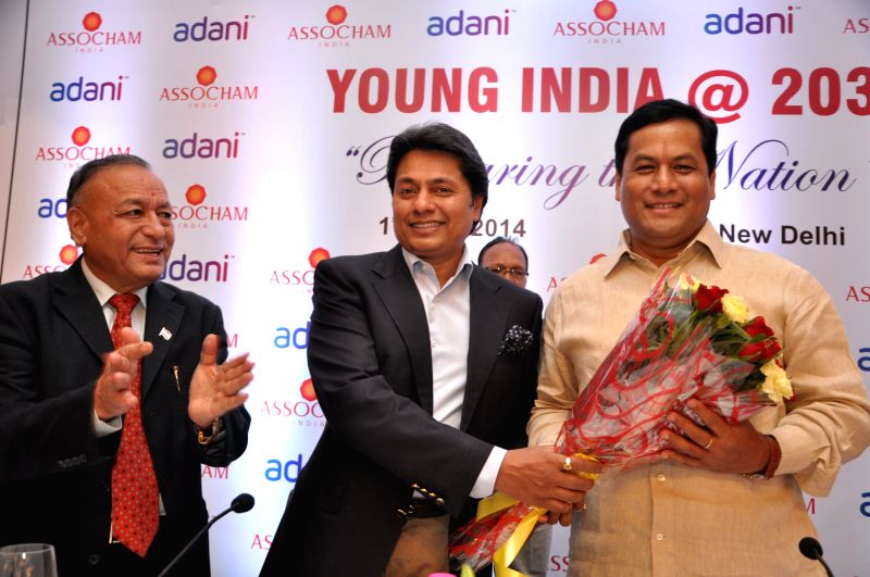 ASSOCHAM Vice President Sandeep Jajodia with Minister of State for Youth Affairs and Sports (Independent Charge) Sarbananda Sonowal during `ASSOCHAM Young India @ 2030 Conclave: Preparing the Nation`