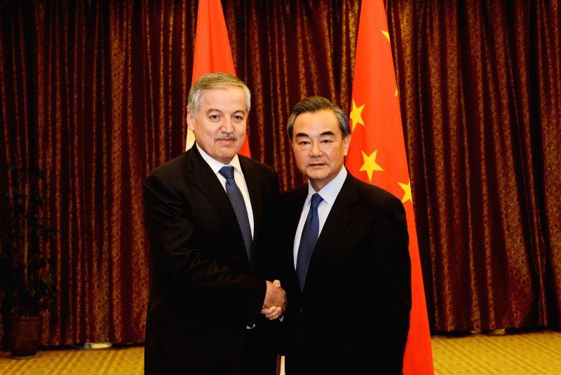 ASTANA, April 22, 2017 - Chinese Foreign Minister Wang Yi (R) meets with his Tajik counterpart Sirojidin Aslov in Astana, Kazakhstan, on April 21, 2017. (Xinhua/Sadat) - Wang Y
