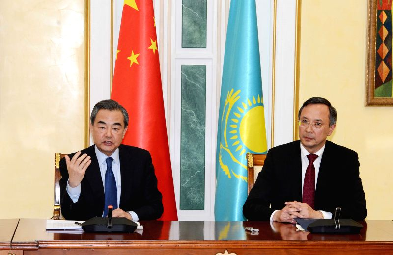 ASTANA, April 22, 2017 - Chinese Foreign Minister Wang Yi (L) and his Kazakh counterpart Kairat Abdrakhmanov attend a joint press conference in Astana, Kazakhstan, on April 21, 2017. - Wang Y