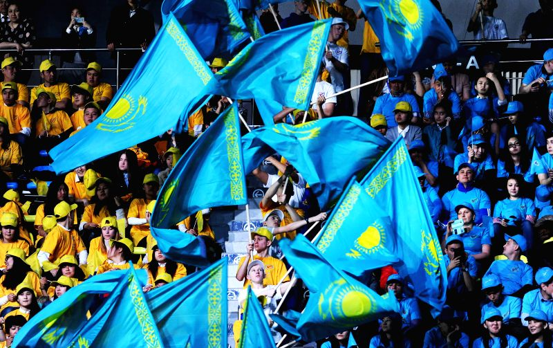 Supporters of Kazakhstan's President Nursultan Nazarbayev wave national flags in Astana, Kazakhstan, April 27, 2015. Preliminary results announced by Kazakhstan's ...