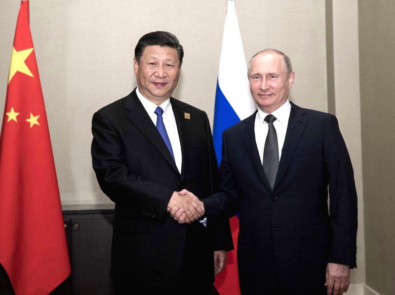 ASTANA, June 8, 2017 - Chinese President Xi Jinping (L) meets with Russian President Vladimir Putin in Astana, Kazakhstan, June 8, 2017.