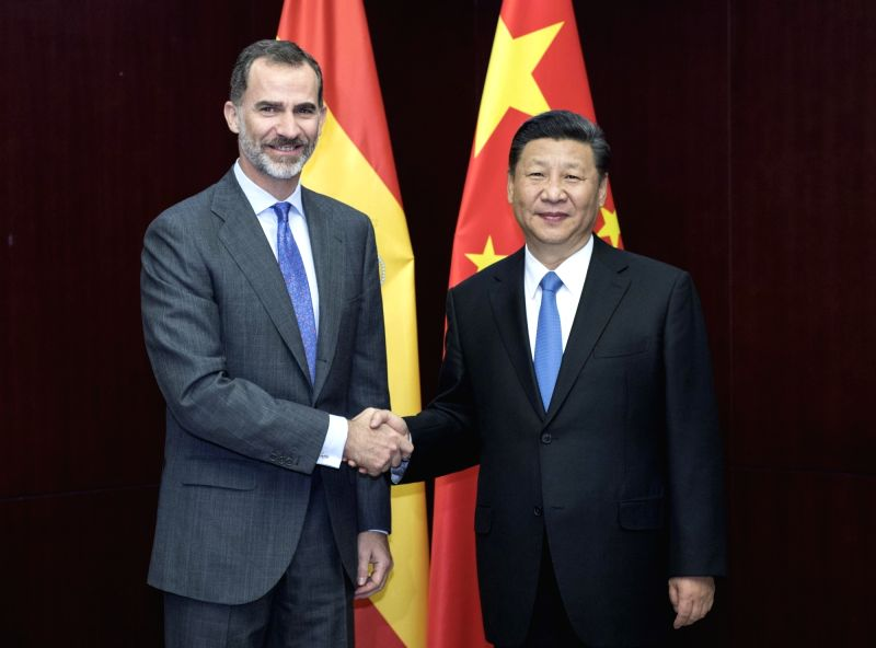 ASTANA, June 9, 2017 - Chinese President Xi Jinping (R) meets with Spanish King Felipe VI in Astana, Kazakhstan, June 9, 2017.