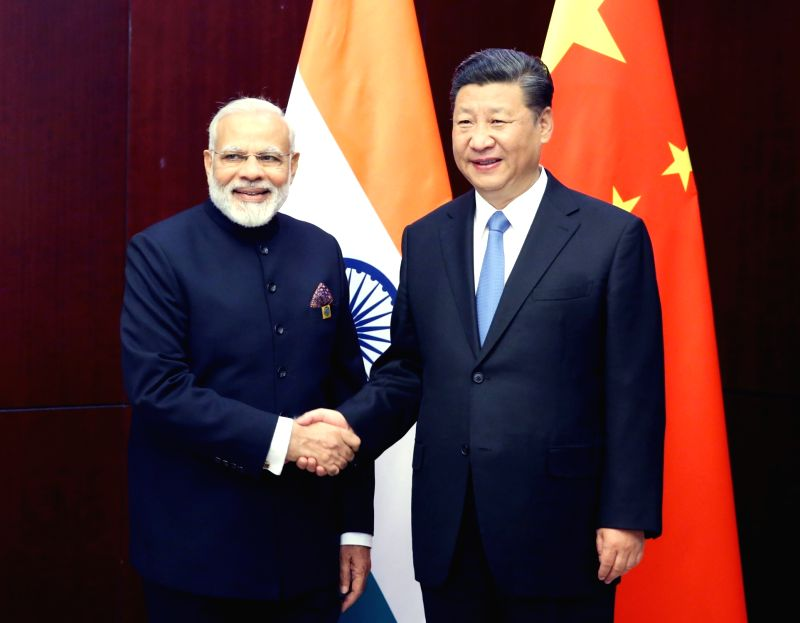 ASTANA, June 9, 2017 - Chinese President Xi Jinping (R) meets with Indian Prime Minister Narendra Modi in Astana, Kazakhstan, June 9, 2017. - Narendra Modi