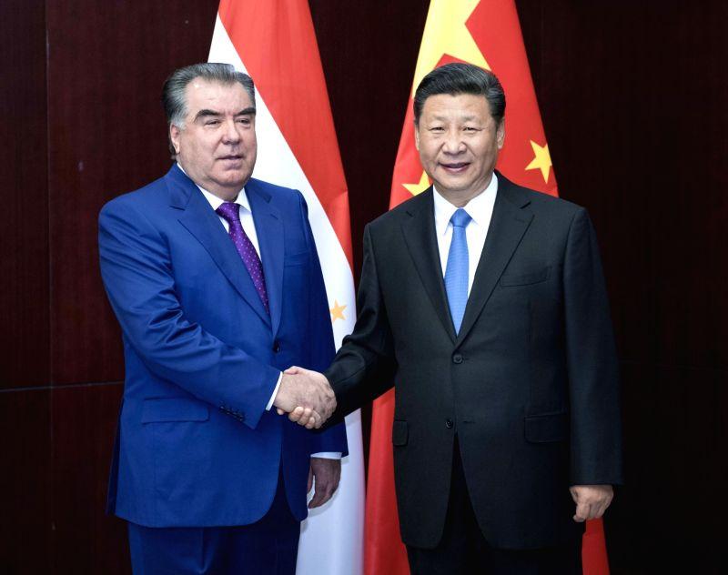 ASTANA, June 9, 2017 - Chinese President Xi Jinping (R) meets with Tajik President Emomali Rahmon in Astana, Kazakhstan, June 9, 2017.