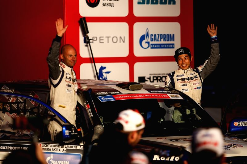 ASTRAKHAN, July 21, 2018 - Japan's Miura Akira (R) and France's Laurent Lichleuchter of Team Land Cruiser Toyota Auto Body enter the podium during the opening ceremony of Silk Way Rally-2018 in ...