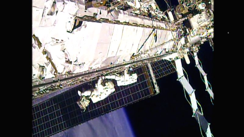 Astronauts Scott Kelly and Kjell Lindgren translate along the port truss structure back to the Quest airlock after completing cooling system servicing work. (Photo: NASA TV)