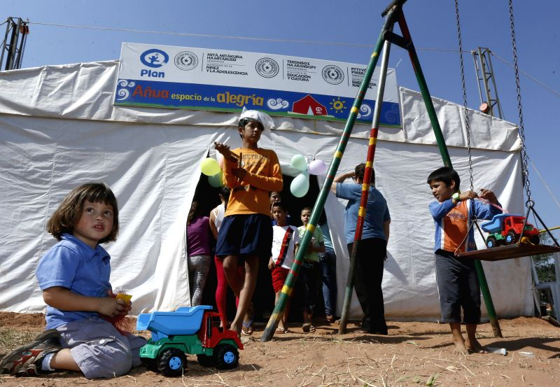 Children play at a camp for flood refugees in the framework of the Children's Day, in Asucion, capital of Paraguay, on Aug. 16, 2014. Paraguay celebrates Children's