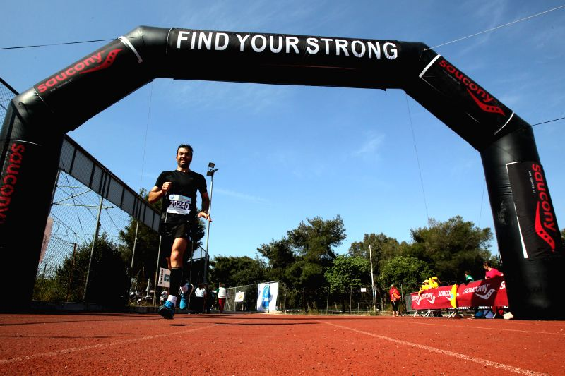A runner participates in Poseidonios Half Marathon in Athens, Greece, April 26, 2015. The event takes place under the auspices of the European Sports for All ...