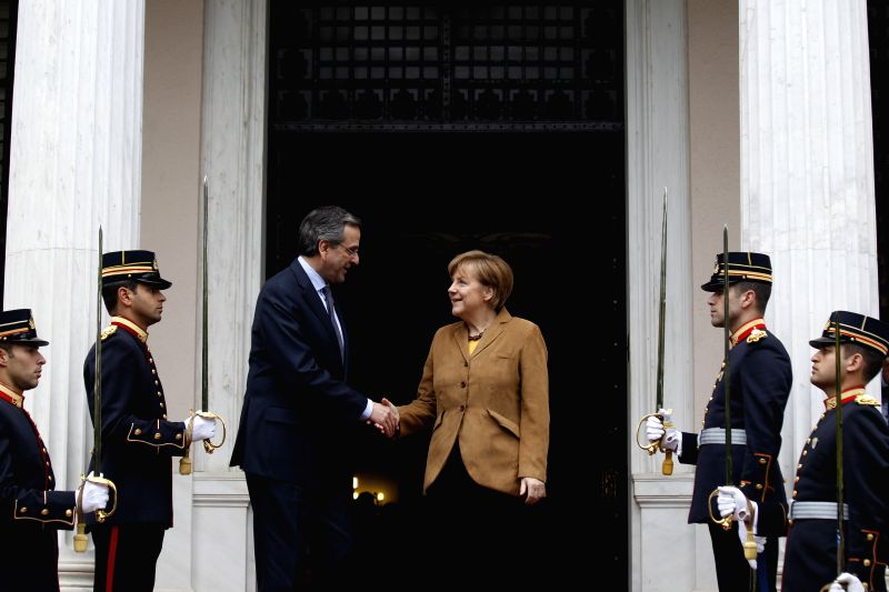 Greek Prime Minister Antonis Samaras (3rd L) greets German Chancellor Angela Merkel (3rd R) on her arrival at the prime minister's office in Athens, Greece, April ..