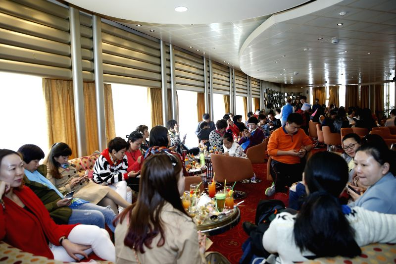 ATHENS, April 22, 2017 - Chinese Tourists rest at a Celestyal Cruises ship in Piraeus, Greece's largest port, on April 21, 2017. The first cruise ship carrying a group of Chinese tourists to the ...