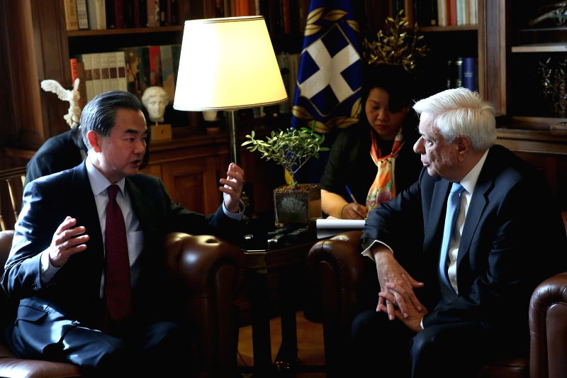 ATHENS, April 24, 2017 - Greek President Prokopis Pavlopoulos (R) meets with visiting Chinese Foreign Minister Wang Yi (L) in Athens April 23, 2017. - Wang Y