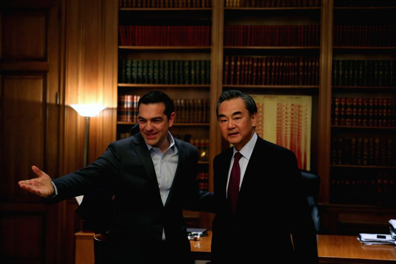 ATHENS, April 24, 2017 - Greek Prime Minister Alexis Tsipras (L) meets with visiting Chinese Foreign Minister Wang Yi in Athens April 23, 2017. - Alexis Tsipras