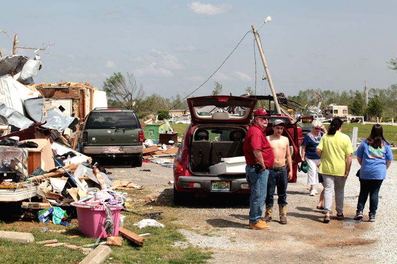 People survey damage at the Billy Bob Trailer Park in Athens in Alabama, the United States, April 29, 2014. Authorities said on Monday that 15 people were killed in
