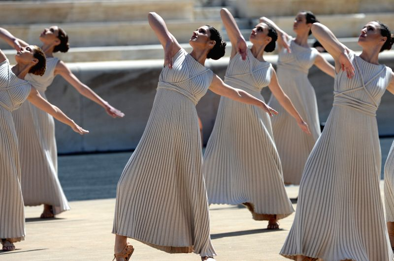 Actresses perform during the Flame Lighting ceremony at the Panathenaic Stadium in Athens, Greece, April 30, 2014. The flame for the Nanjing Youth Olympics was lit .