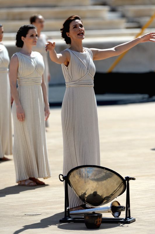 Greek actress Katerina Lehou (front), playing the role of high priestess, recites eulogy during a handover ceremony at Panathenaean Stadium in Athens, Greece, April - Katerina Lehou