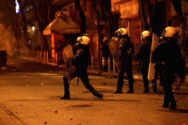 Greek riot police stand guard during clashes in central Athens, Greece, on April 7, 2015. Dozens of rioters clashed with riot police in central Athens Tuesday, ...