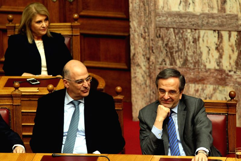 Greek Prime Minister Antonis Samaras (1st R) attends the second round of voting to elect a new Greek president at the Parliament in Athens, Greece, Dec. 23, 2014. .. - Antonis Samaras