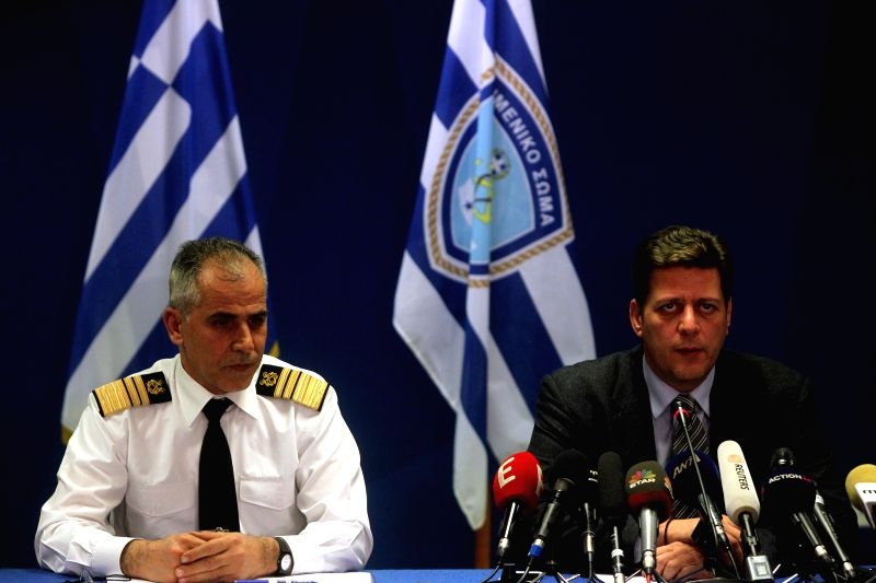 Greek Shipping Minister Miltiadis Varvitsiotis(R) speaks during a press briefing at Piraeus, Greece, on Dec. 28, 2014. There was a victim in the Italian-flagged ... - Miltiadis Varvitsiotis