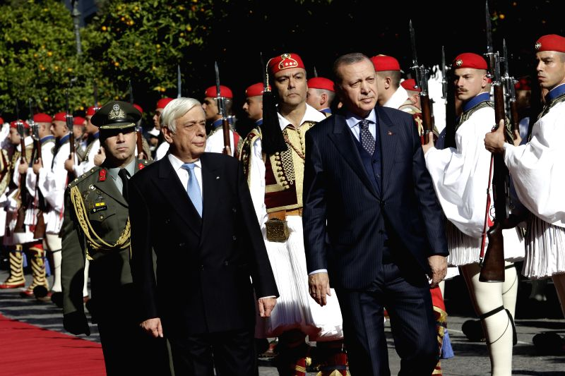 ATHENS, Dec. 7, 2017 - Greek President Prokopis Pavlopoulos (L) and Turkish President Recep Tayyip Erdogan (R) inspect the Greek Presidential Guards during a welcome ceremony in Athens, Greece, on ...