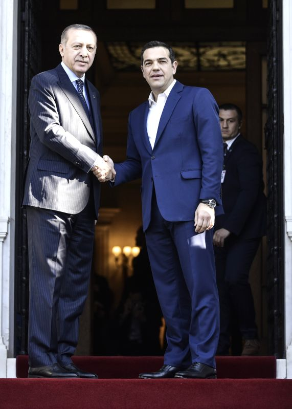 ATHENS, Dec. 7, 2017 - Greek Prime Minister Alexis Tsipras (R) and Turkish President Recep Tayyip Erdogan (L) shake hands prior to their meeting in Athens, Greece, on Dec. 7, 2017. Turkish President ... - Alexis Tsipras