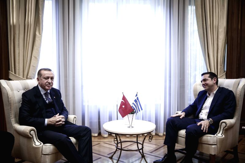 ATHENS, Dec. 7, 2017 - Greek Prime Minister Alexis Tsipras (R) speaks with Turkish President Recep Tayyip Erdogan (L) in their meeting in Athens, Greece, on Dec. 7, 2017. Turkish President Recep ... - Alexis Tsipras