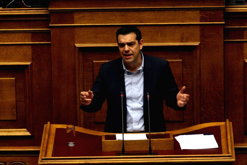 Greek Prime Minister Alexis Tsipras addresses lawmakers during a parliamentary session before a vote of confidence in Athens, Greece, Feb. 10, 2015. Greece cannot ... - Alexis Tsipras