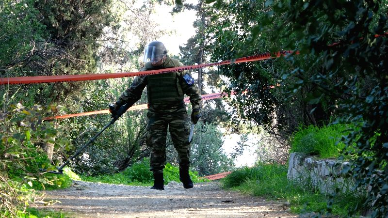 ATHENS, Feb. 2, 2018 - A military expert searches Philopappou Hill following the discovery of a mortar shell in central Athens, Greece, Feb. 1, 2018. Remnants of a mortar shell from World War II were ...