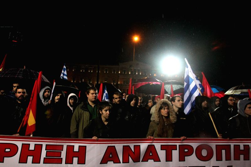 Greek Communist Party members take part in a rally to protest against the recent agreement reached between Greece and the Eurogroup, at Syntagma Square, Athens, ...