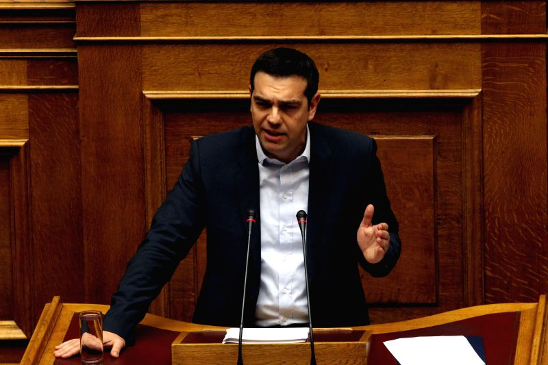 Greece's new prime minister Alexis Tsipras addresses the parliament during government's policy statement in Athens, Greece, Feb. 8, 2015. Greece's new government will