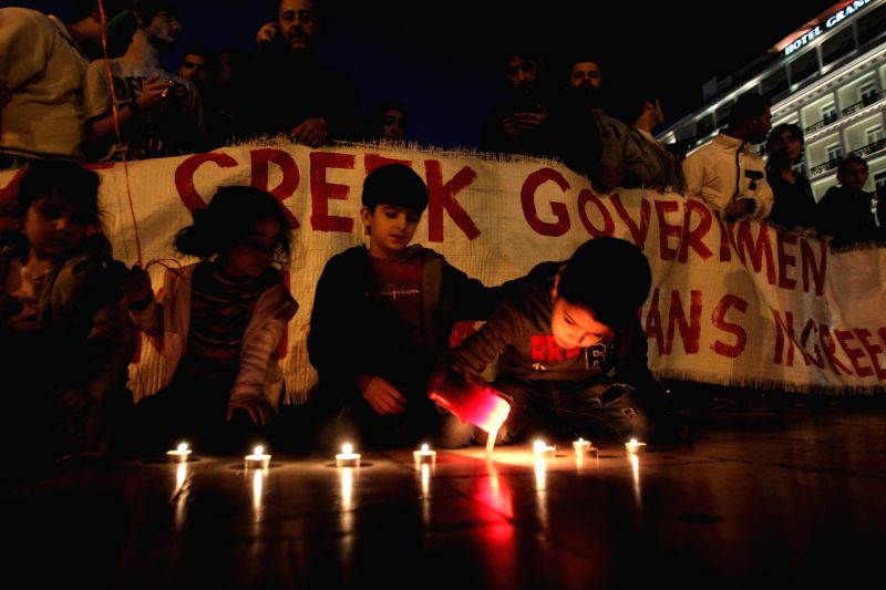 Athens (Greece): Refugees from Syria take part in a protest outside Greece's Parliament in Athens, Greece, Nov. 19, 2014, calling on Greek Government to provide assistance to refugees from the ...
