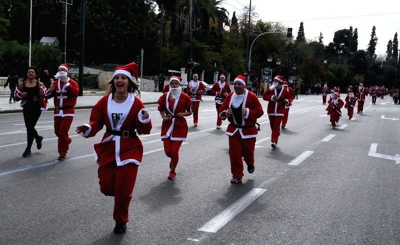 "Athens (Greece): Runners wearing Santa Claus suits attend the first ""Santa Run"" race in Athens, capital of Greece, Dec. 7, 2014."