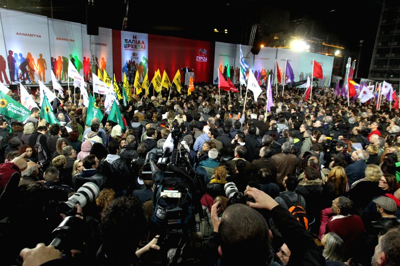 People attend the rally of Greece's SYRIZA left-wing main opposition party, at Omonia Square in Athens, Greece, Jan. 22, 2015. In opinion surveys, the radical left ..