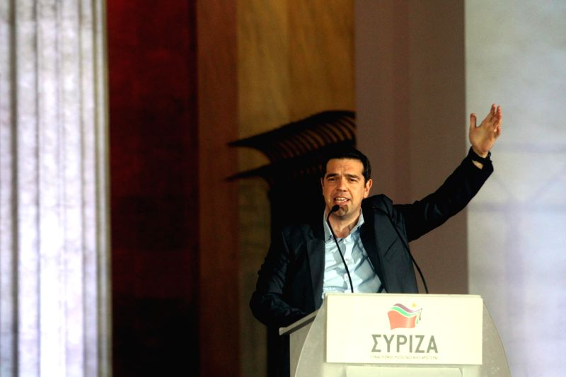 Radical Left SYRIZA leader Alexis Tsipras speaks to his supporters outside Athens University Headquarters in Athens, Greece, Jan. 25, 2015. Radical Left SYRIZA ...