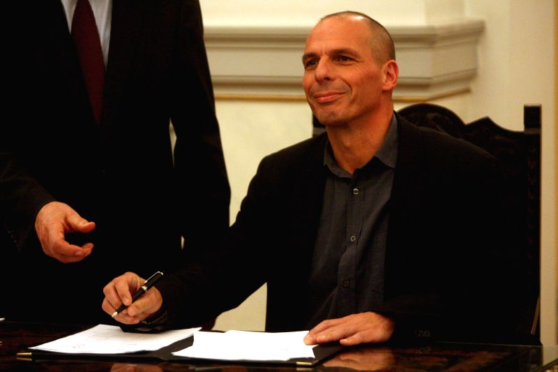 Greece's new Finance Minister Yanis Varoufakis is seen after a swearing-in ceremony at the Presidential Palace in Athens, Greece, Jan. 27, 2015. Greece's new ... - Yanis Varoufakis
