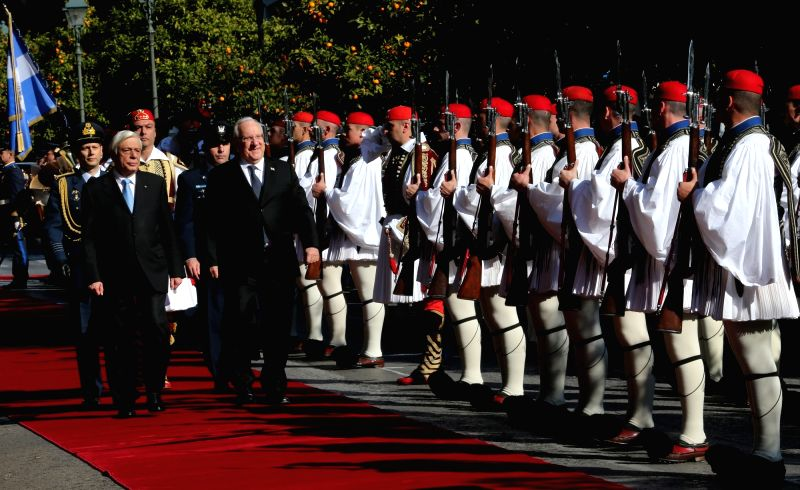 ATHENS, Jan. 29, 2018 - Greek President Prokopis Pavlopoulos (L, front) and Israeli President Reuven Rivlin (R, front) view guards of honor during a welcome ceremony at the presidential mansion in ...