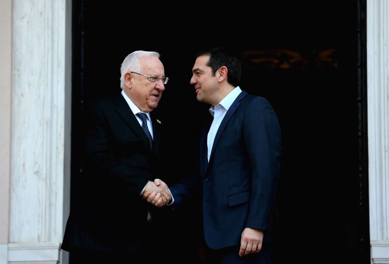 ATHENS, Jan. 29, 2018 - Greek Prime Minister Alexis Tsipras (R) shakes hands with Israeli President Reuven Rivlin at the Maximos Mansion in Athens, Greece, on Jan. 29, 2018. Greek leaders and Israeli ... - Alexis Tsipras
