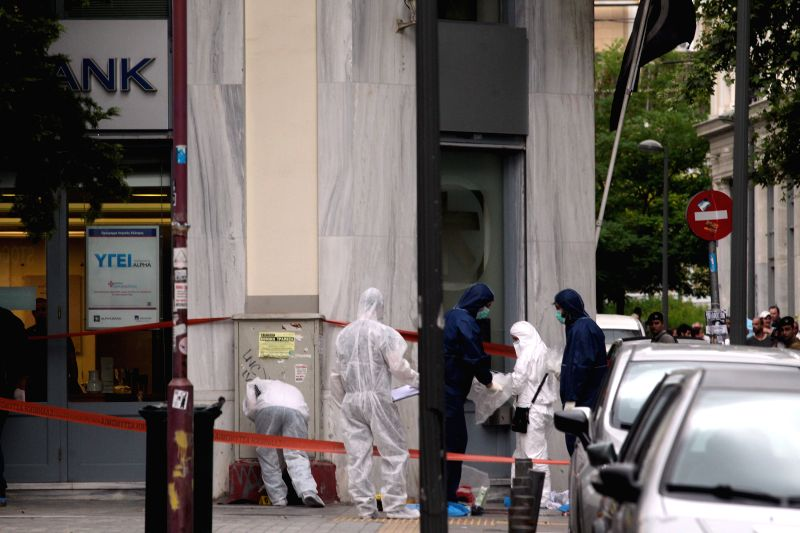 Greek policemen cordon off the area around a bank robbery shootout in central Athens, Greece, July 16, 2014. Greek police have arrested the leader of a local ...
