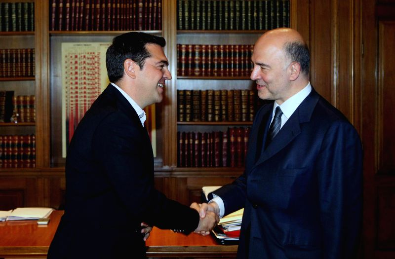 ATHENS, July 18, 2016 - Greek Prime Minister Alexis Tsipras (L) shakes hands with European Commissioner for Economic and Financial Affairs Pierre Moscovici before their meeting in Athens, Greece, on ... - Alexis Tsipras