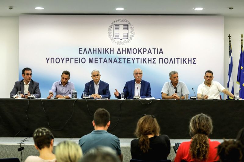ATHENS, July 18, 2018 - Greek Migration Minister Dimitris Vitsas (3rd R, Rear) attends a press conference in Athens, Greece, on July 18, 2018. Greek Migration Minister Dimitris Vitsas urged on ... - Dimitris Vitsas