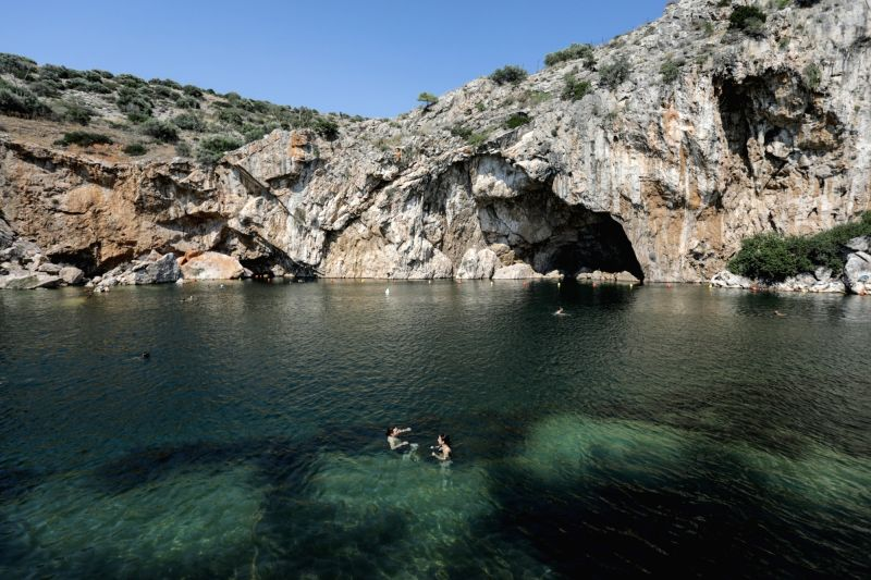 ATHENS, July 20, 2018 - Photo taken on July 19, 2018 shows people swimming in Vouliagmeni Lake in south region of Athens, Greece. Situated on an idyllic landscape, the rare geological phenomenon of ...