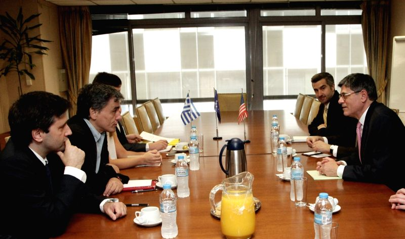 ATHENS, July 21, 2016 - Greek Finance Minister Euclid Tsakalotos(2nd L) meets with U.S. Treasury Secretary Jack Lew(1st R) in Athens, Greece on July 21, 2016. Athens needed to continue its reform ... - Euclid Tsakalotos