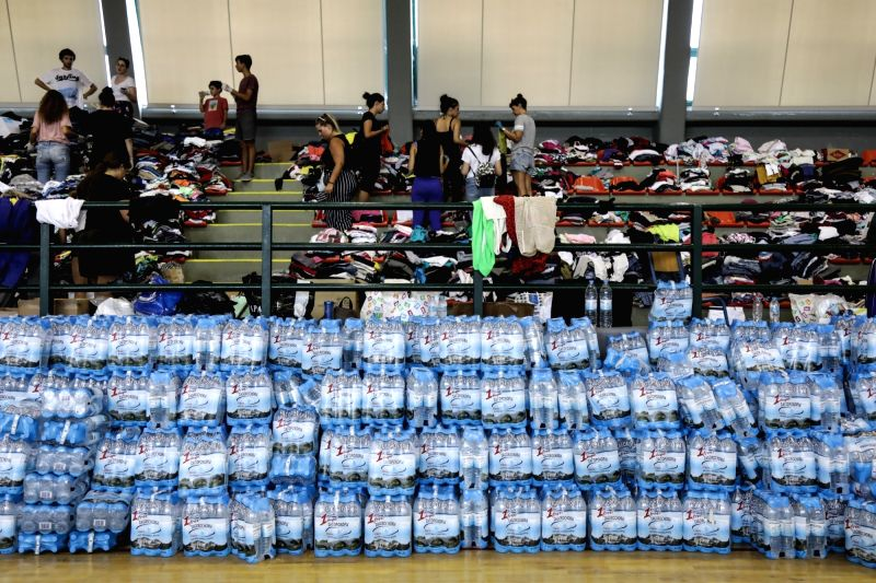 ATHENS, July 26, 2018 - Volunteers collect relief items at a basketball court in Rafina, east of Athens, Greece, on July 26, 2018. As Greece mourned its deadliest tragedy caused by wildfires in over ...