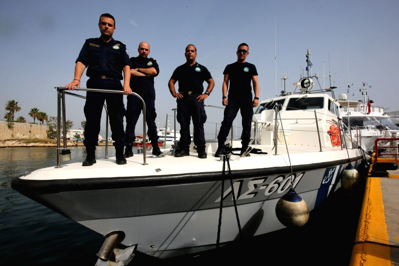 ATHENS, June 10, 2018 - Photo taken on June 8, 2018 shows Greek coast-guards standing on a coast-guard boat, at Marina Zeas, in Athens, Greece. The search and rescue operations of thousands of ...