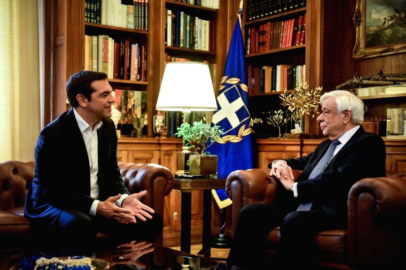 ATHENS, June 12, 2018 - Greek Prime Minister Alexis Tsipras (L) meets with Greek President Prokopis Pavlopoulos to announce that Athens and Skopje have reached a historic agreement on their name row, ... - Alexis Tsipras