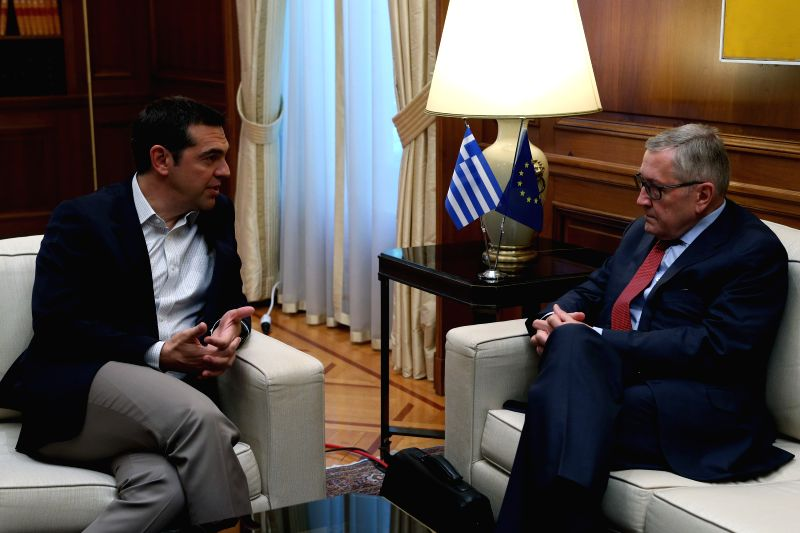 ATHENS, June 13, 2018 - Greek Prime Minister Alexis Tsipras (L) talks with European Stability Mechanism (ESM) chief Klaus Regling in Athens, Greece, June 13, 2018. Greece can become a new success ... - Alexis Tsipras