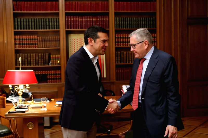 ATHENS, June 13, 2018 - Greek Prime Minister Alexis Tsipras (L) shakes hands with European Stability Mechanism (ESM) chief Klaus Regling in Athens, Greece, June 13, 2018. Greece can become a new ... - Alexis Tsipras