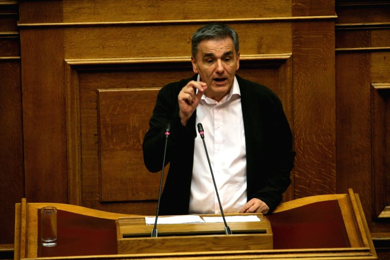 ATHENS, June 14, 2018 - Greek Finance Minister Euclid Tsakalotos speaks at a parliamentary session in Athens, Greece, on June 14, 2018. Greece's government passed on Thursday the last set of measures ... - Euclid Tsakalotos