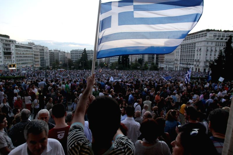 Demonstrators rally in front of the Greek Parliament to support Greece's place in the Eurozone, in Athens, Greece, June 18, 2015. As the potential exit of Greece ...